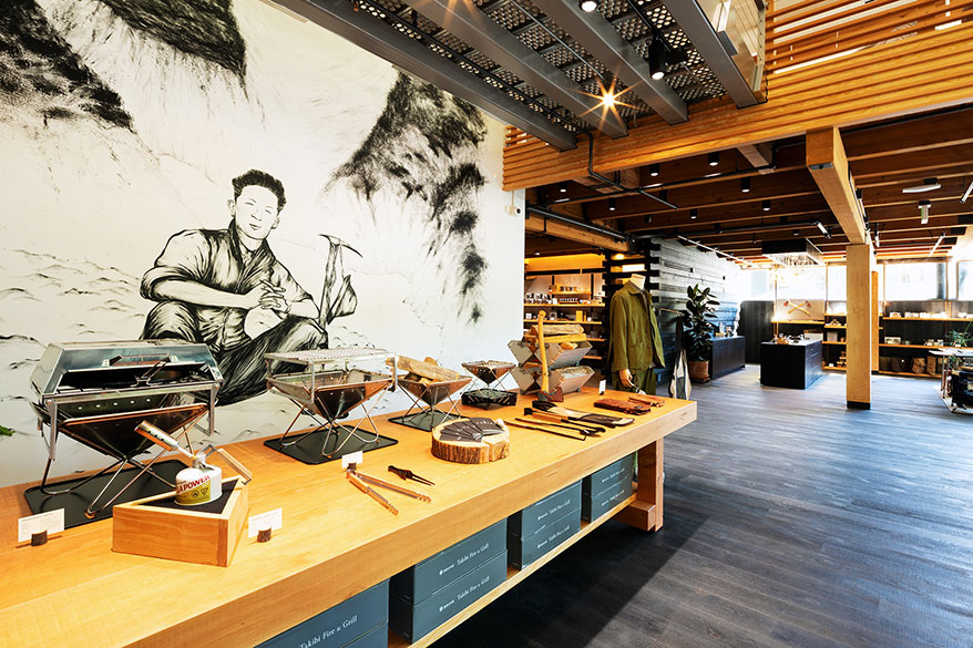 A hand-painted mural by a Seattle-based Japanese artist features the brand's founder.