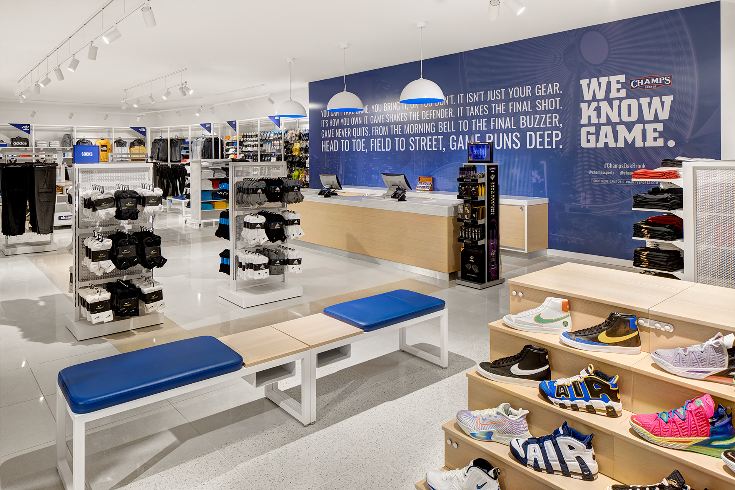 Situated on the first floor, the Champs area is demarcated by its signature white and blue brand colors.